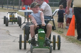 Child in pedal pull competition