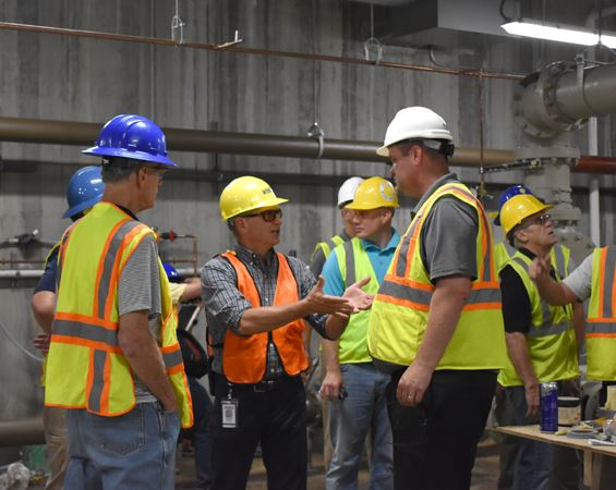 Men in hard hats talk in building