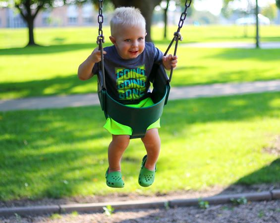 Boy on swing at park