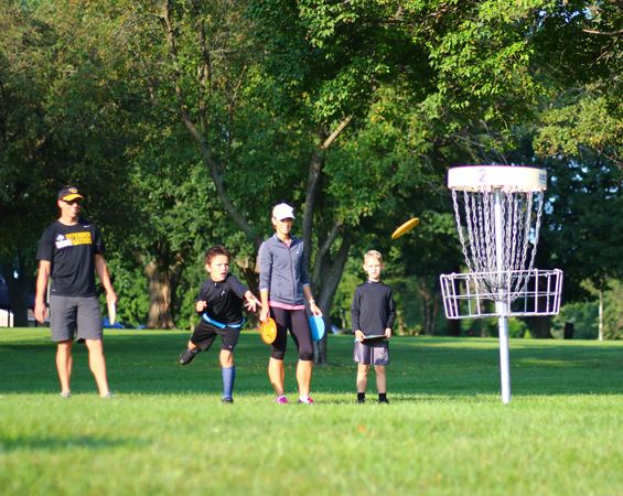 Four people play disc golf