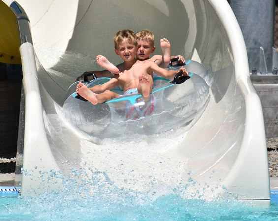 Boys on water slide