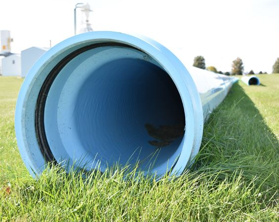 large blue pipe on the grass