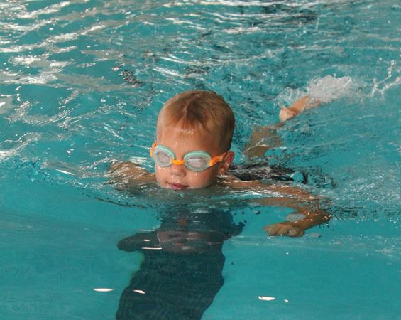 Child swims in pool
